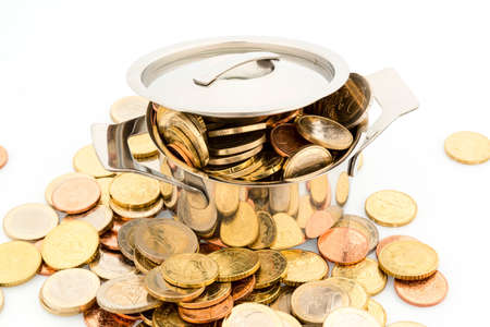 a saucepan is filled with euro coins, symbolic picture for subsidies
