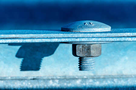 hexagon bolt and nut, symbol of connection, reliability, cooperation Stock Photo