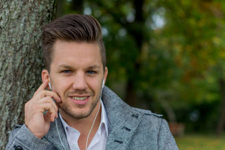 man listens to music on the mobile phone Stock Photo