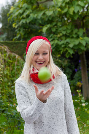 woman with apple. vitamins in the fall