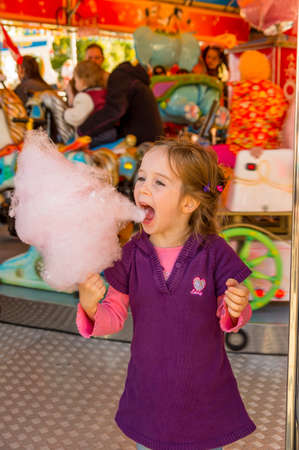 Child on kirtag with cotton candy