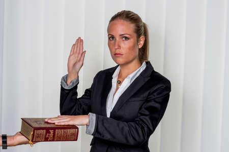 woman swears on the bible