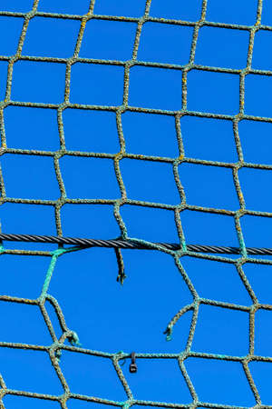hole in a net Stock Photo
