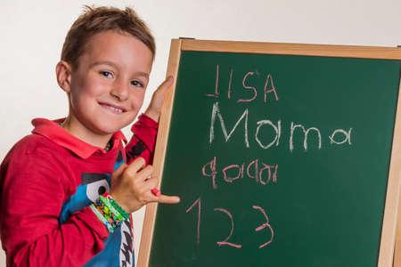 schoolchild with school blackboard Stock Photo