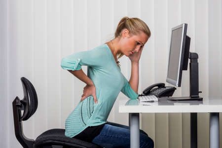woman with backache in the office Banque d'images