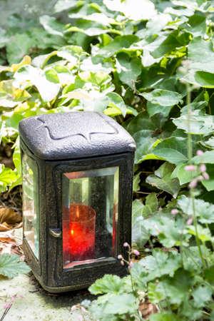 grave light and gravestone
