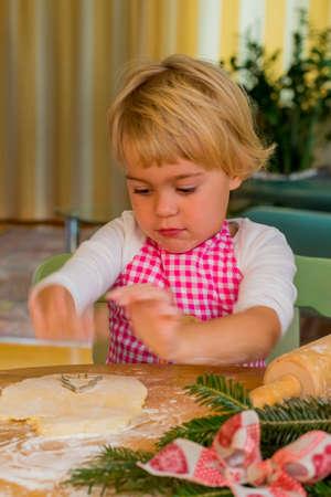 child bake cookies for christmas Stock Photo
