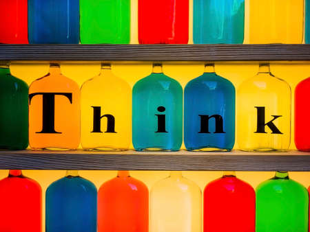 colored bottles with the word THINK