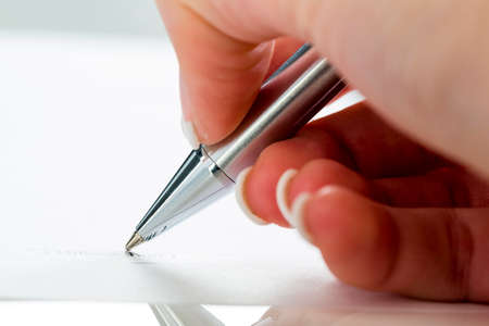 hand with fountain pen at signature Stock Photo