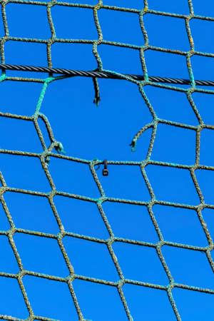 hole in a net Standard-Bild