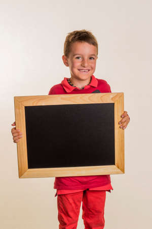 schoolchild with school blackboard Stock Photo