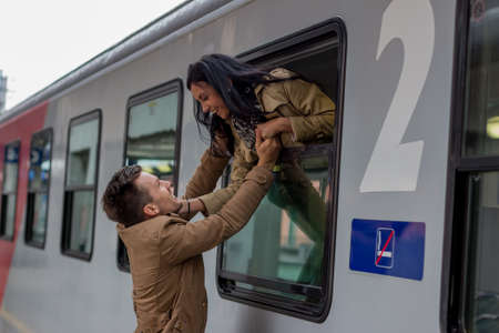 Couple saying good bye in the train
