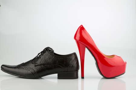 red high heels and mens shoe Standard-Bild