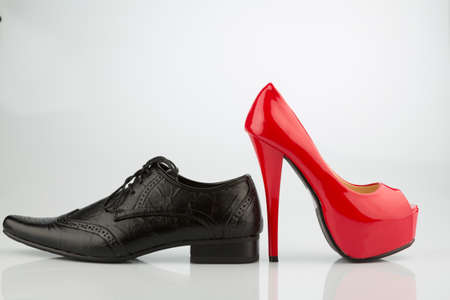 red high heels and mens shoe Foto de archivo