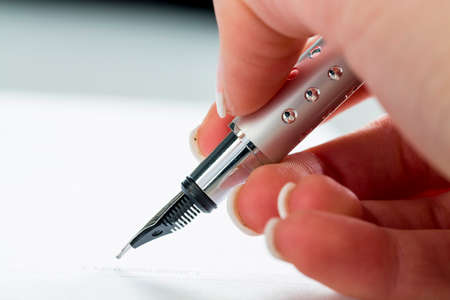 hand with fountain pen at signature Standard-Bild
