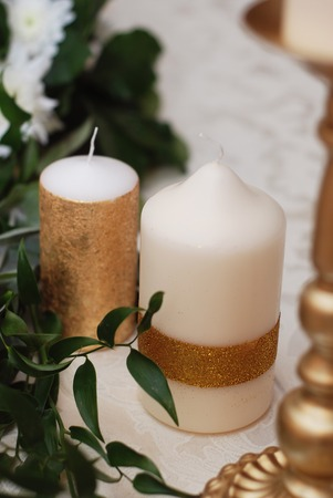 Decorative candle with gold stripe