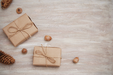 Rustic gift kraft boxes with ribbon bow, with pinecone Stock Photo - 85817533