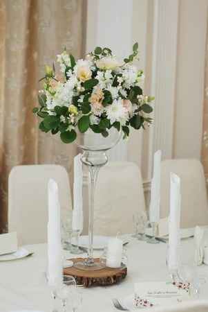 Flower arrangement in glass table. Wedding decoration.