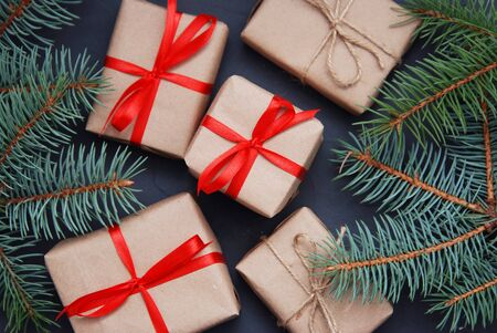 original ecological: Wrapping eco Christmas packages with brown paper, string and natural fir branches