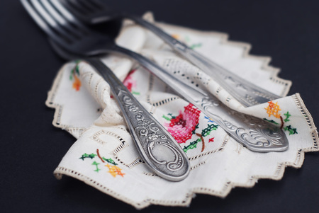 Silver fors on Embroidered kitchen napkin close