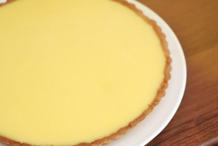Homemade Lemon Cheesecake Pie on Yellow Background