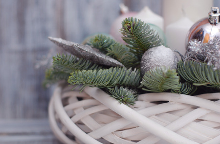 Winter or Christmas centerpiece wreath with candles Stock Photo
