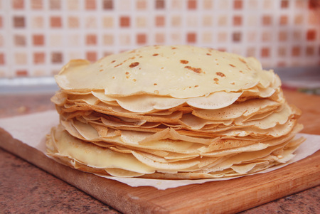 Crepes or thin traditional russian pancakes isolated, selective focus. food photography.