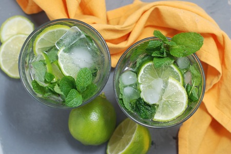 Mohito Alcohol Drink. Two Glasses with Cocktail Drinks and Ice cubes Stock Photo