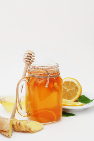 Glass of Fruit tea Dring. Ginger, lemon and Honey. Health food Concept.