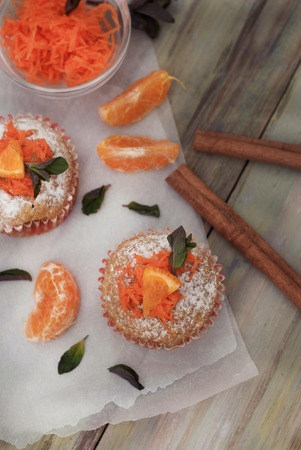 Carrot Healthy Muffins Cupcakes Buns on a WoodenRustic board. Homemade bakery