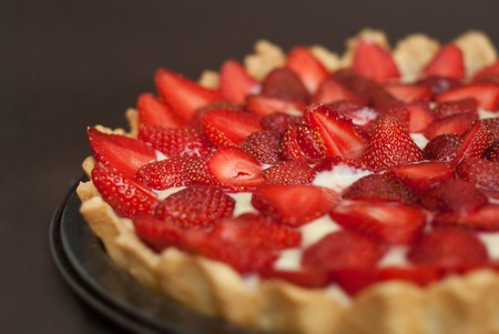 Strawberry Tarttlet with Cream home Made over Gray Background Isoalted Fruit Cake Stock Photo