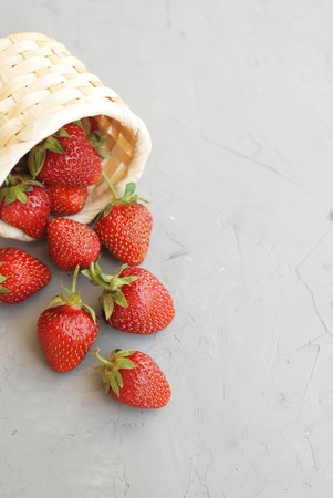 Fresh Strawberries Summer Fruit Vitamine with Strawberries Textured Cement Gay Background 写真素材