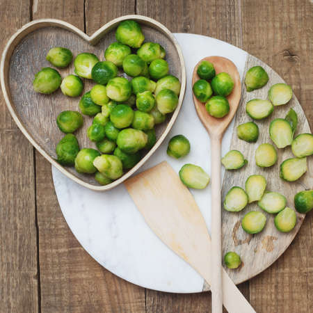 Healthy Food Brussel Sprout Cabbage isolated Rustic Wooden Background Stockfoto