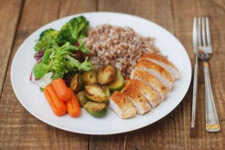 Dietetics Healthy Buckwheat Beef Meat Breast Chicken Chicken Salad Cabbage Brussels Carrots Rustic Background Foto de archivo