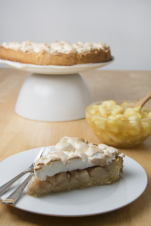 Piece of pear cake or pie, with meringue on the plate