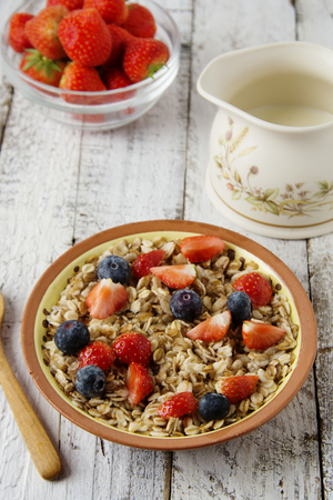 Healthy Homemade Oatmeal with Berries - fresh strwberries and blueberries, for Breakfast.