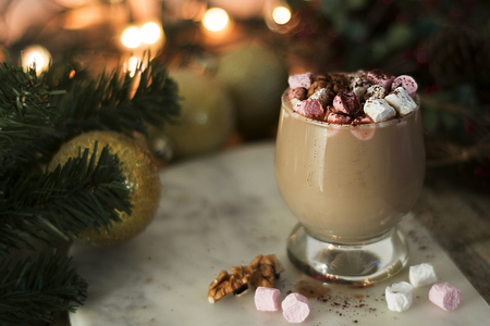 Hot chocolate or cocoa drink, with marshmallows on Christmas background. 写真素材