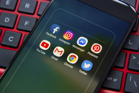 Corby, United Kingdom - January 27, 2019: Smartphone with icons of social media on screen, smartphone life style Stock Photo - 117571369