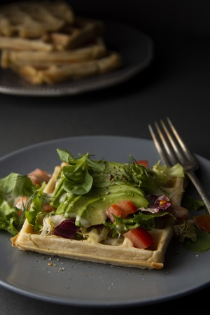 Belgian Waffles with avocado and tomatoes. Perfect breakfast for healthy food or lose weight. Avocado sandwich.