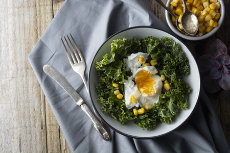 Poached eggs with Kale lettuce and corn salad. Healthy breakfast or dinner. Lose weigh, clean eating.