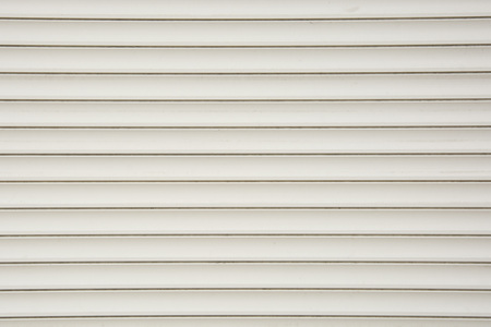 Close up of a roller shutter door, plastic white texture Stock Photo