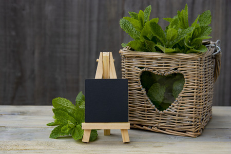 Summer drinks ingredients concept. Chalkboard with peppermint leaves. Garden eco mint leaves. Rustic style. Copy space