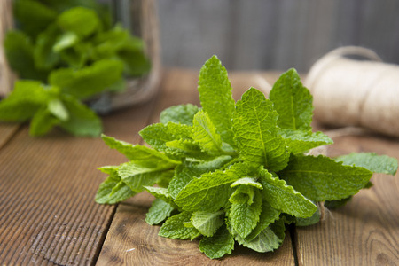 Close up mint leaves on wooden background. Summer drinks or dessert ingredient. Rustic style. Isolated mint. 写真素材