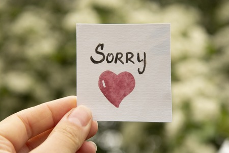 Sorry. Sticker with sorry inscription and red heart. I'm sorry lettering