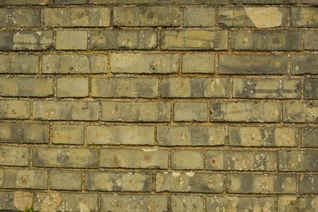Old, yellow real stone brick wall Stock Photo