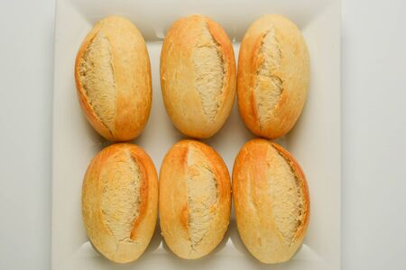 Whole grain wheat bread buns isolated on white Stock Photo