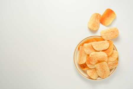 Potato chips in a plate isolated on a white