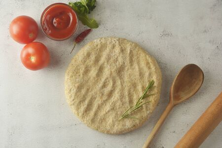 Composition with raw dough and fresh ingredients for pizza isolated on light background. Copy space.
