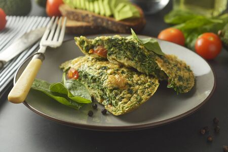 Omelet with spinach leaves. Healthy omelette for lose weight. Healthy food. Breakfast.