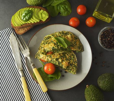 Omelet with spinach leaves. Healthy omelette for lose weight. Healthy food. Breakfast. Square image.
